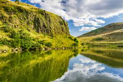 View of mountain lake in summer Stock Photos