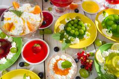 table laden with various kinds of jellies - stock photo