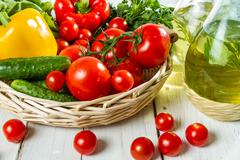 vegetables in a basket and olive oil - stock photo