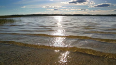 lake landscape with shallow sand bottom - stock footage