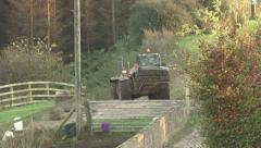 Loader with pallet of turf on bumpy track. Stock Footage