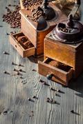 Making coffee by vintage grinders Stock Photos