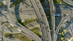Aerial footage, Flying over the road junction aerial minimal traffic - stock footage