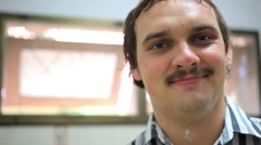 Smiling young moustached man in scars on face. HD. 1920x1080 Stock Footage