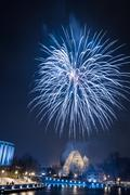 Spectacular fireworks over river at night Stock Photos