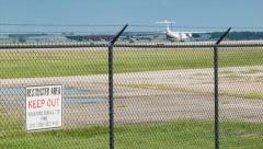 Restricted Area Airport Fence with Private Airplane Takeoff Stock Footage