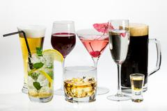 Various types of alcohol on a white background Stock Photos
