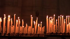 Faithful lighting candles in the Church Stock Footage
