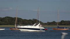 Motor boat cruises into harbour, lymington, england Stock Footage