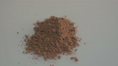 Cocoa powder on white background Stock Footage