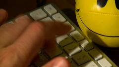 Stressed typing extreme close up Stock Footage