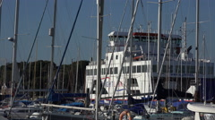 Wightlink ferry passes marina at lymington from isle of wight, england Stock Footage