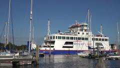 Wightlink ferry enters marina at lymington from isle of wight, england Stock Footage