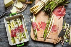 asparagus wrapped in parma ham casserole - stock photo
