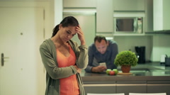 Sad woman after quarrel with his boyfriend standing in the kitchen - stock footage