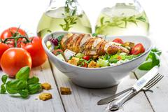 Fresh salad made of chicken, tomato, olive and fresh herbs Stock Photos