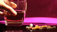 Pills and alcohol - Substance Abuse - stock footage