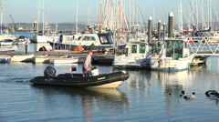 Young man manoeuvres a rib boat to trailer at lymington, england Stock Footage