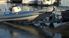 4x4 car pulls boat and trailer out of water at lymington, england Stock Footage