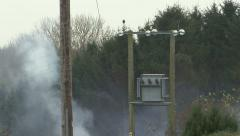Smoke near high voltage electricity transformer. Stock Footage