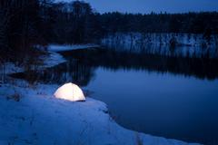 accommodation extreme location in the winter night - stock photo