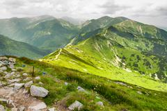 view of trail on the mountain tops - stock photo