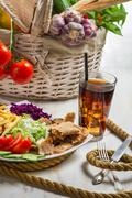 Vegetables and meat kebab served with fries and a coke Stock Photos