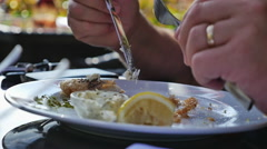 Eating Fish & chips on a sunny day, slow motion Stock Footage