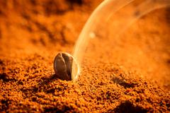 Aroma of roasted coffee grains background Stock Photos