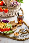 vegetables, fries and meat kebab served with cold coke - stock photo