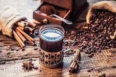 freshly brewed coffee with the scent of cinnamon - stock photo