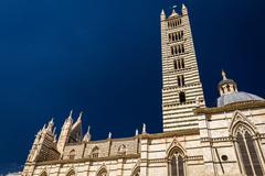 Cathedral in siena on a blue sky background Stock Photos