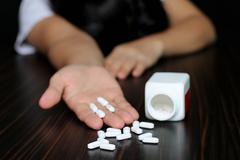 Women overdose on pills Stock Photos