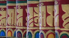 Buddhist prayer wheels in Tibetan monastery with written mantra. India Stock Footage