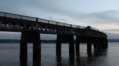 Train crossing Tay Rail Bridge Dundee Scotland Stock Footage