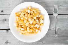 quebec's most popular traditional fast food - la poutine - stock photo