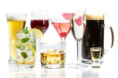 Different kinds of alcohol on a white background Stock Photos