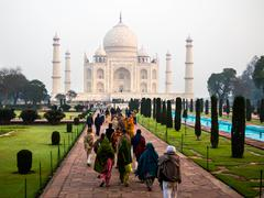 Visitors at the Taj Mahal in Agra, India - stock photo