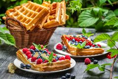 waffles with fresh collected berry fruit - stock photo