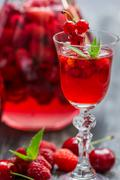 liqueur made of wild berries and mint - stock photo