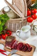 Basket full of fresh vegetables and ham Stock Photos