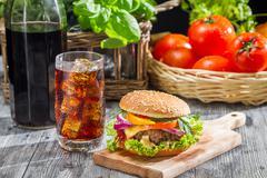 homemade hamburger and a coke with ice - stock photo