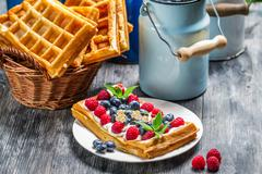 waffles with berry fruit and whipped cream - stock photo