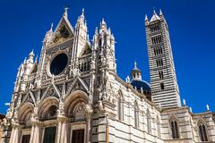 Siena cathedral on a blue sky background Stock Photos