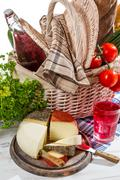 basket full of fresh vegetables and cheese - stock photo