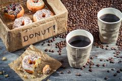 box full of donuts with coffee for two - stock photo
