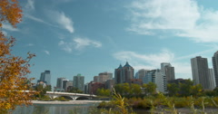 Skyline of Calgary with the Bow River and Louise Riley bridge. Stock Footage