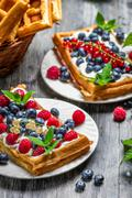 closeup of waffles with fresh berry fruit - stock photo