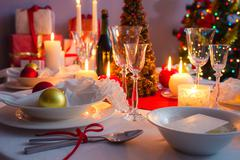 Christmas dishware on the white and red table Stock Photos