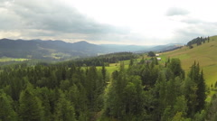 Flight over hill and wood in mountains. Aerial  shot  Stock Footage